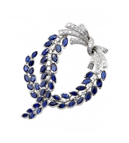 Broche ITALIA, compuesto por diamantes y zafiros de Ceylán para las novias más refinadas que deseen una pieza de alta joyería